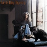 Carole King and cat sitting on window sill